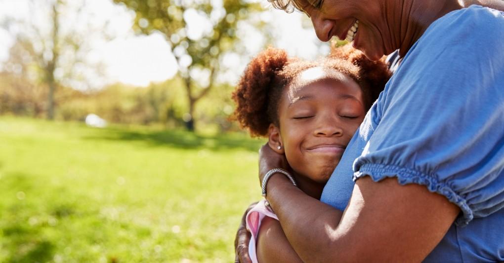 grandmother giving granddaughter a warm hug