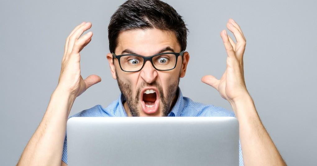 angry man yelling at a computer