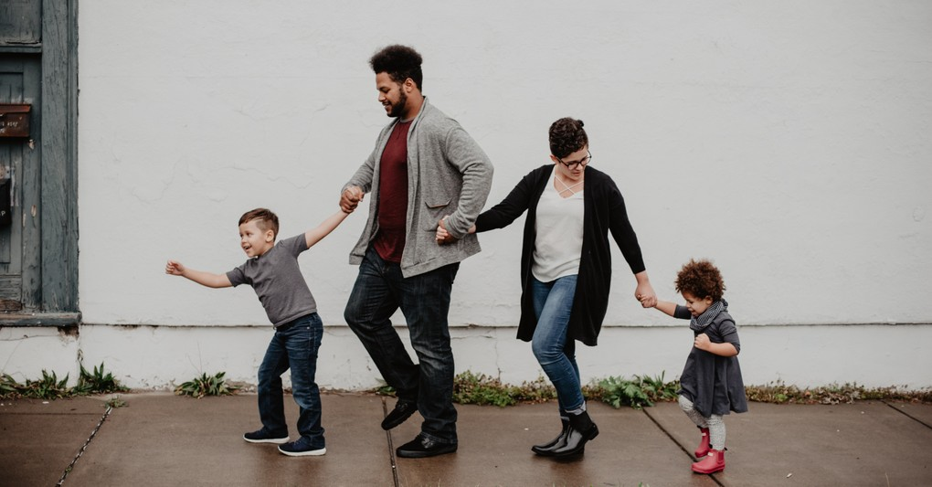 family walking together on side walk, prayer of protection family