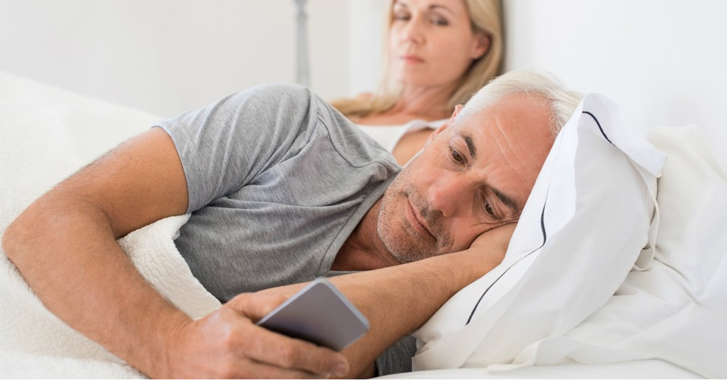 man in bed with phone ignoring wife, what does bible say about neglecting wife