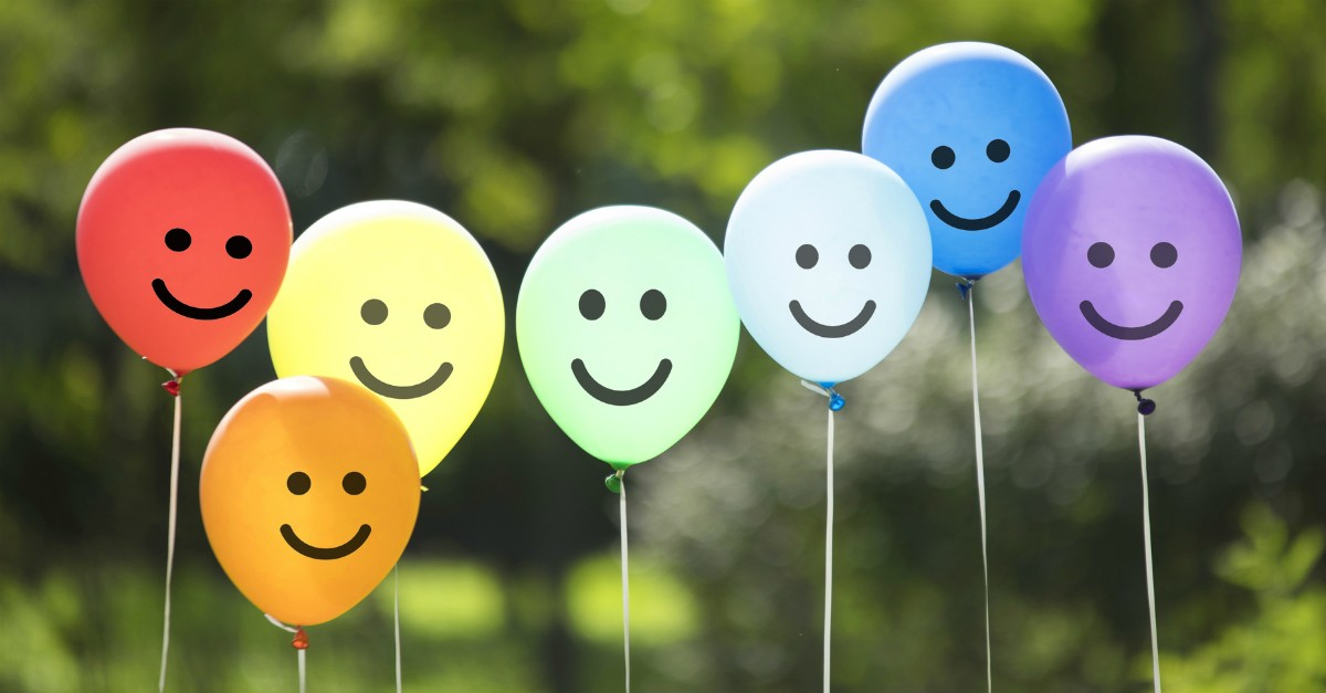 Line of balloons with happy faces
