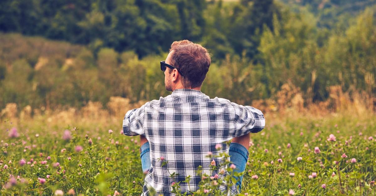 Man resting in a quiet field