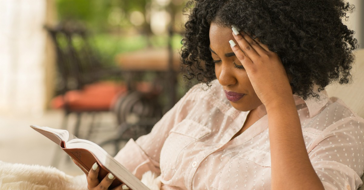 Woman reading the Bible intenetly
