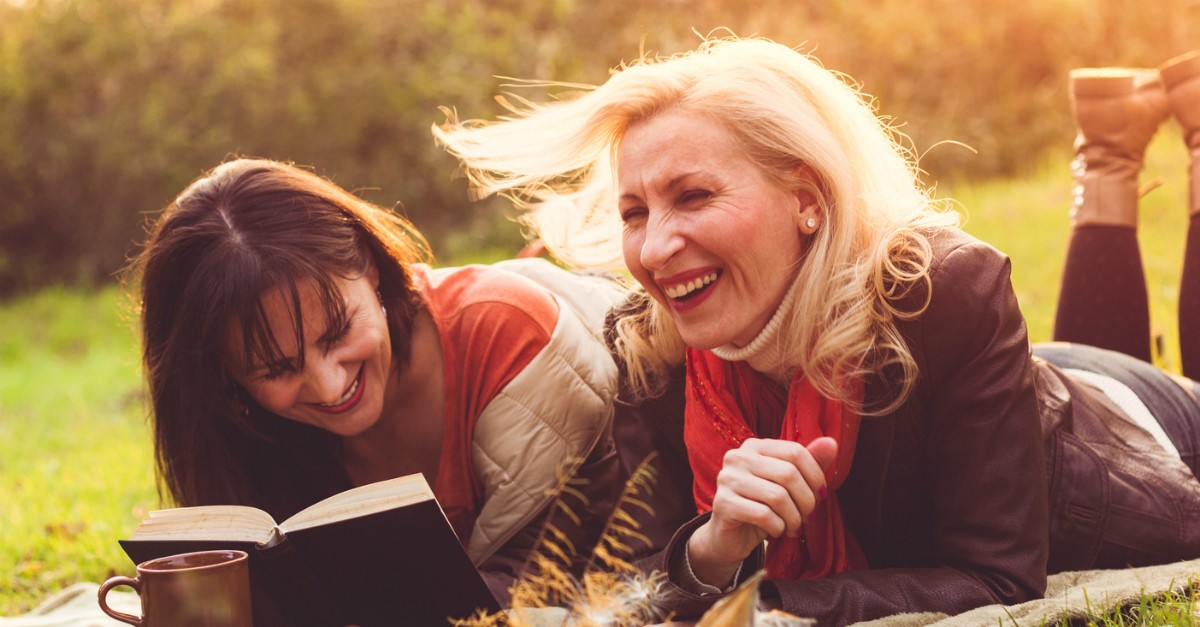Two women outside laughing