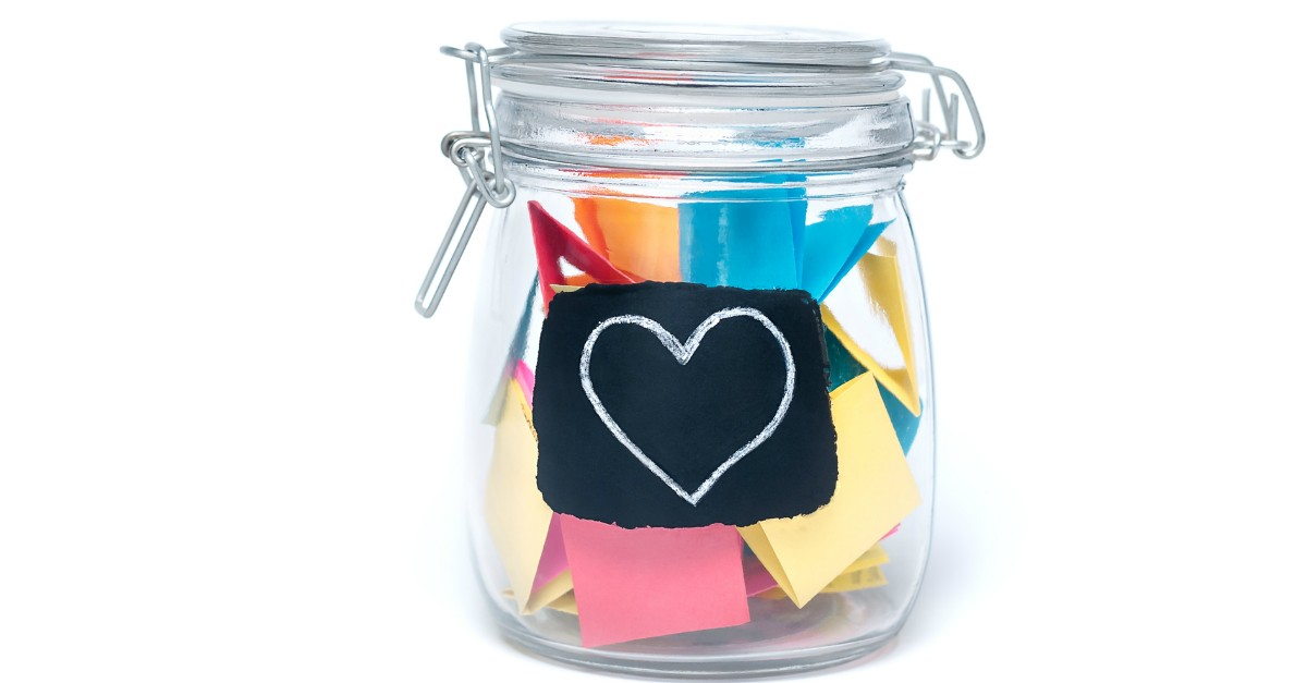 Glass jar full of happy notes