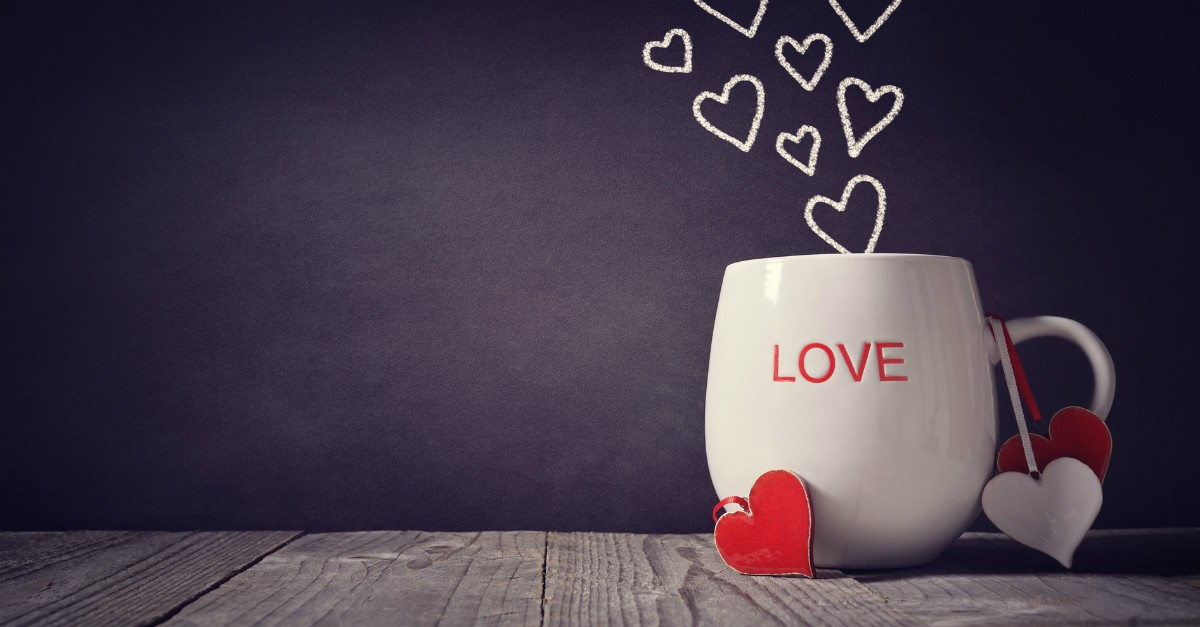 cup of love with hearts rising from it overflow