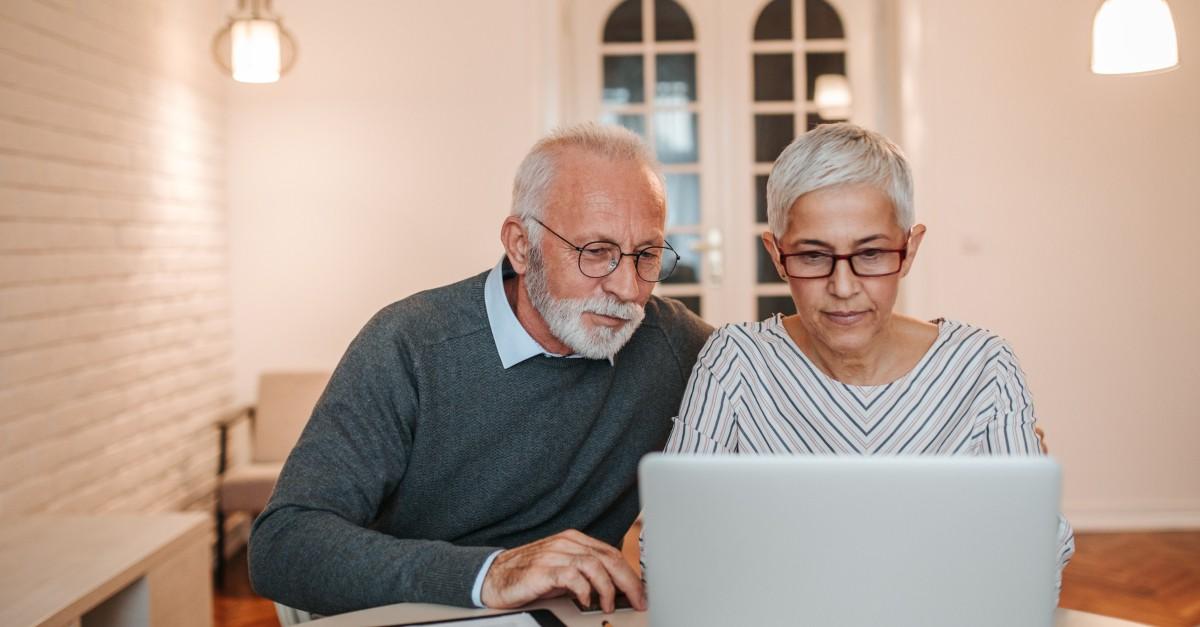 senior couple looking at laptop planning finances