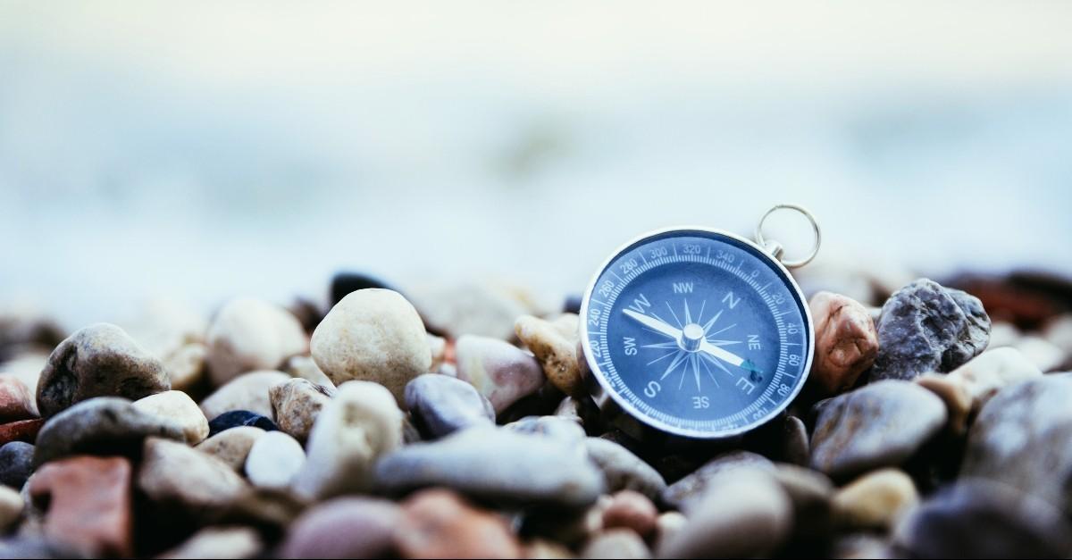 Compass on a stony beach