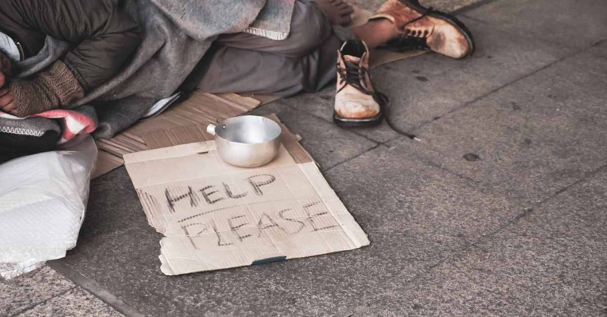 homeless man sleeping on street, who is my neighbor jesus calls out passivity