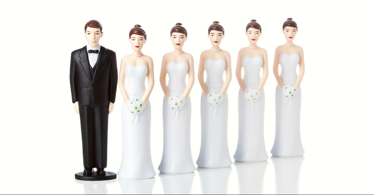 Groom and three bride cake toppers