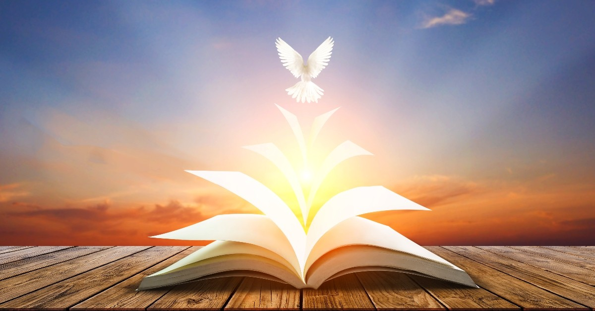 Dove flying out of the Bible