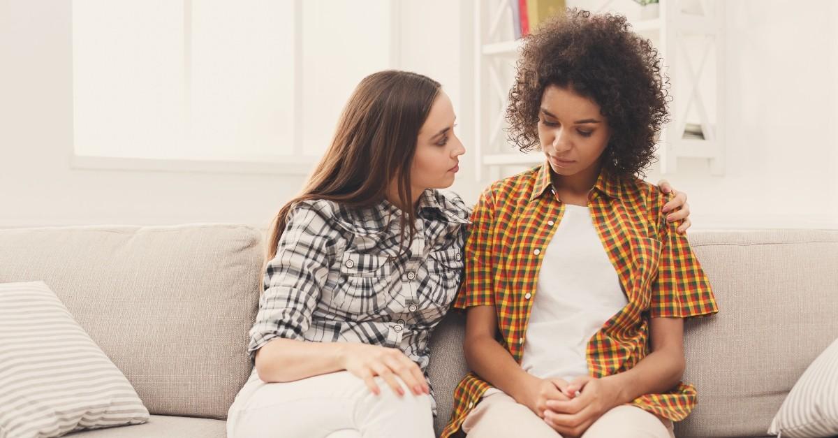 Two women having a serious conversation