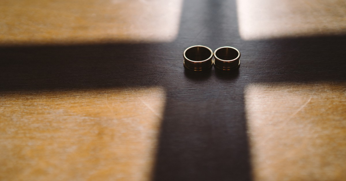 wedding rings on cross on bible - bride of christ in the bible
