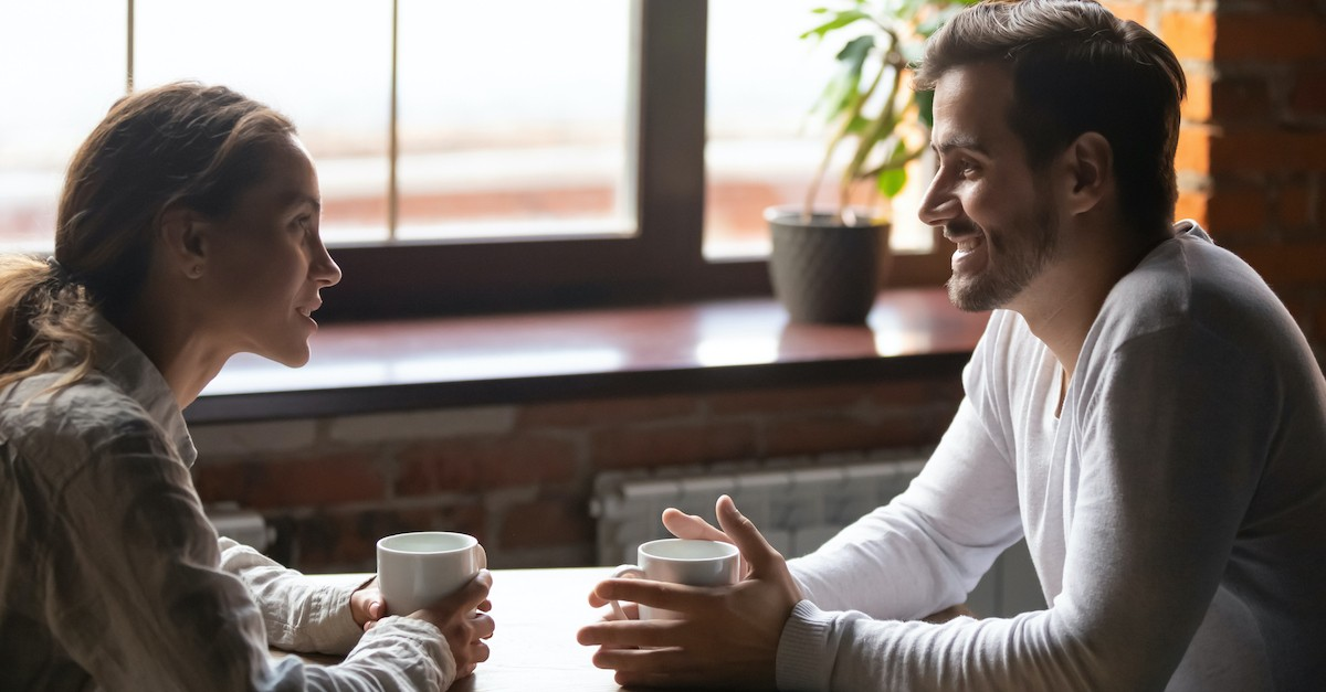 couple happily talking on date at coffee shop, dating advice tips