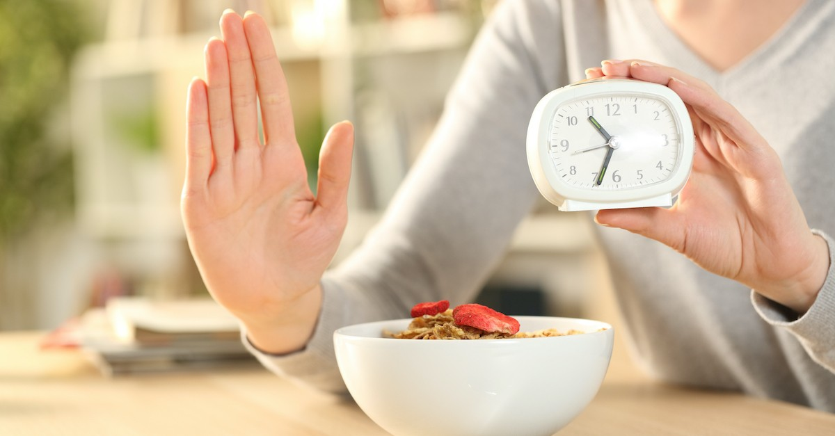 woman refrains from eating cereal, fasting and prayer