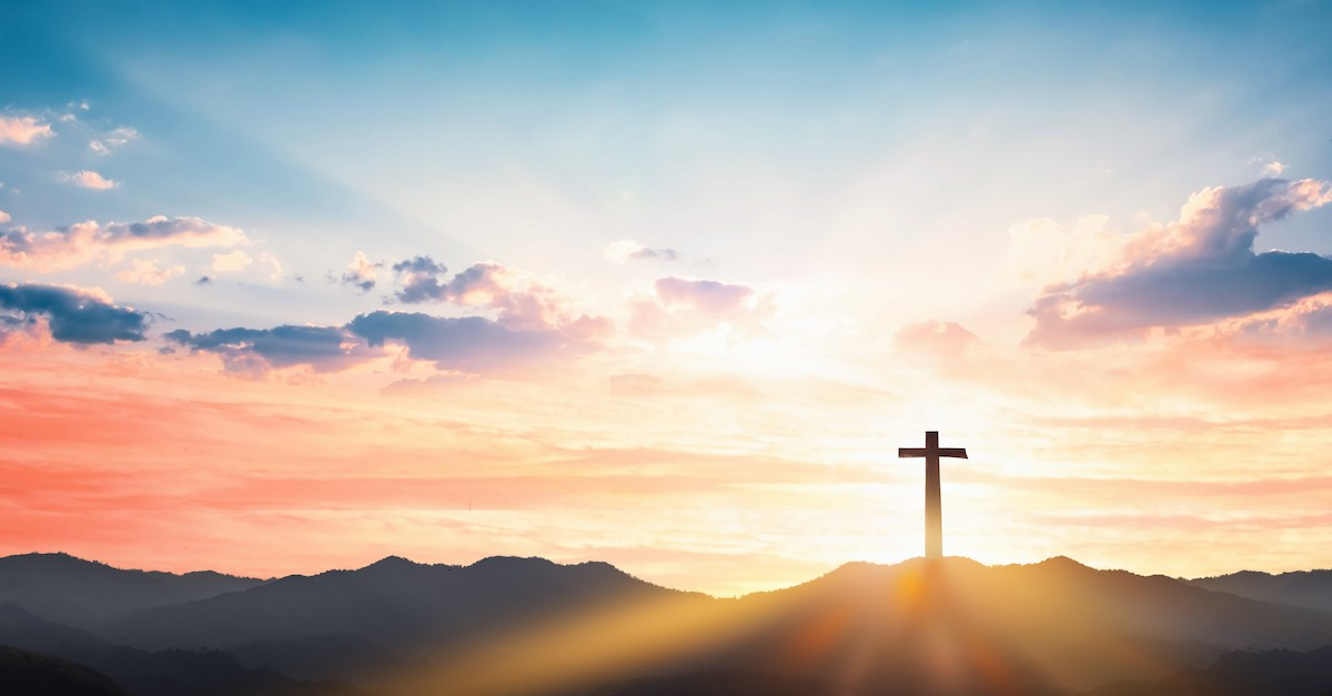 silhouette of Cross at sunset in beautiful scenic outdoors, Christianity beliefs