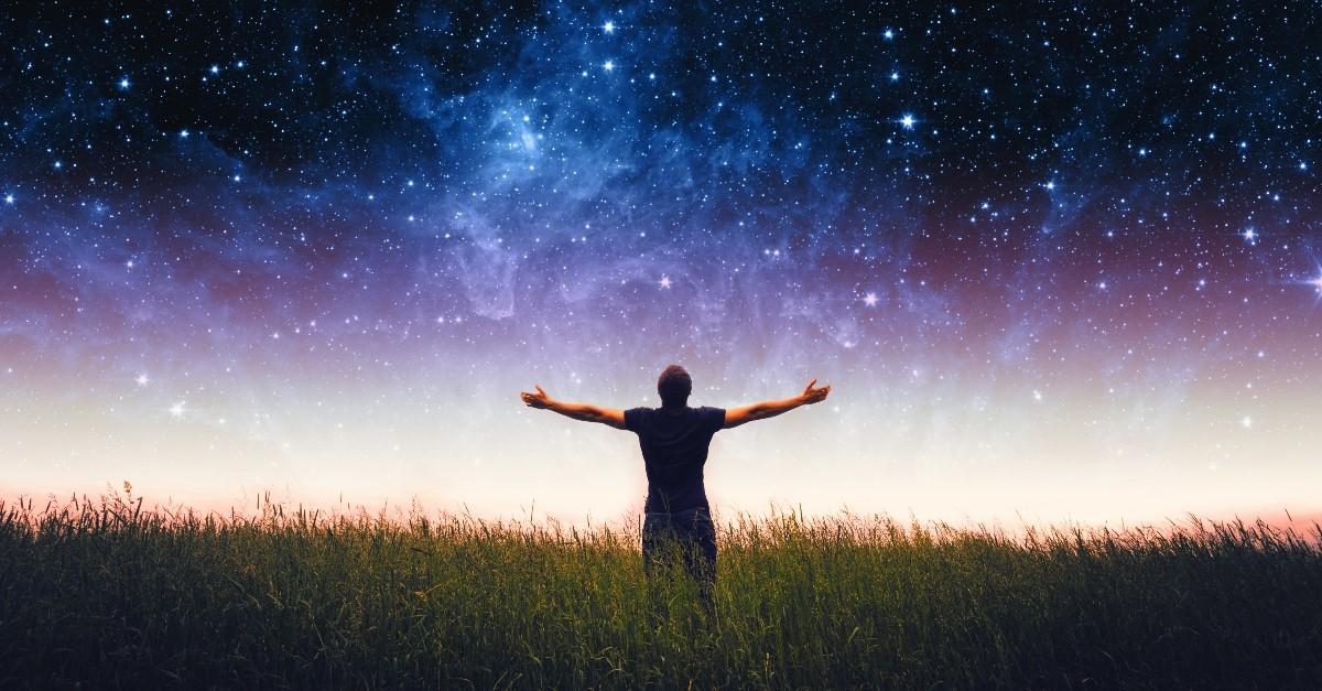 Man standing under a star-studded sky