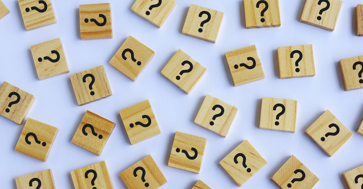 wooden tiles with question marks spread over white background, God is not the author of confusion
