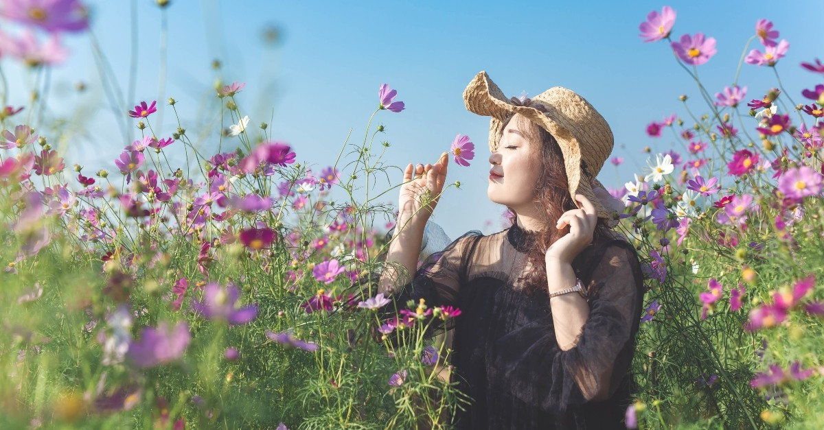 Woman smelling spring flowers