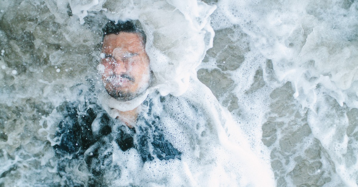 man covered in water, credo-baptism