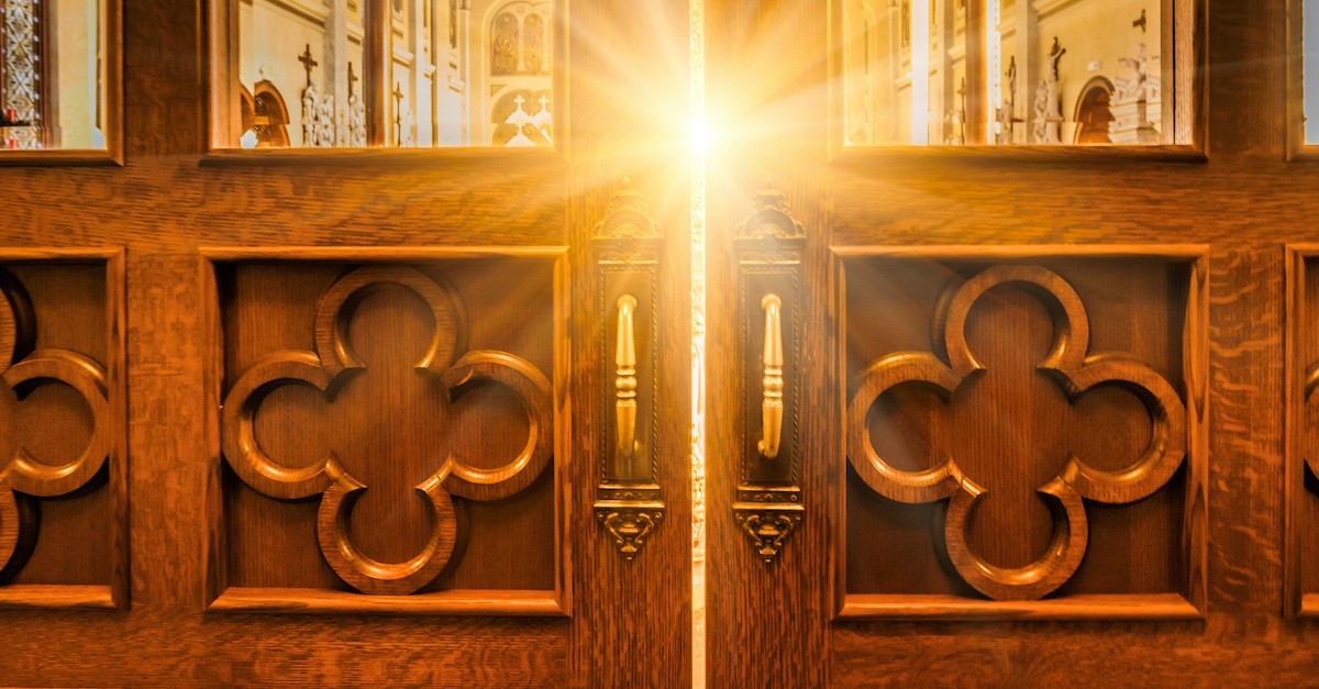 church doors with bright light shining through window, behold I stand at the door and knock