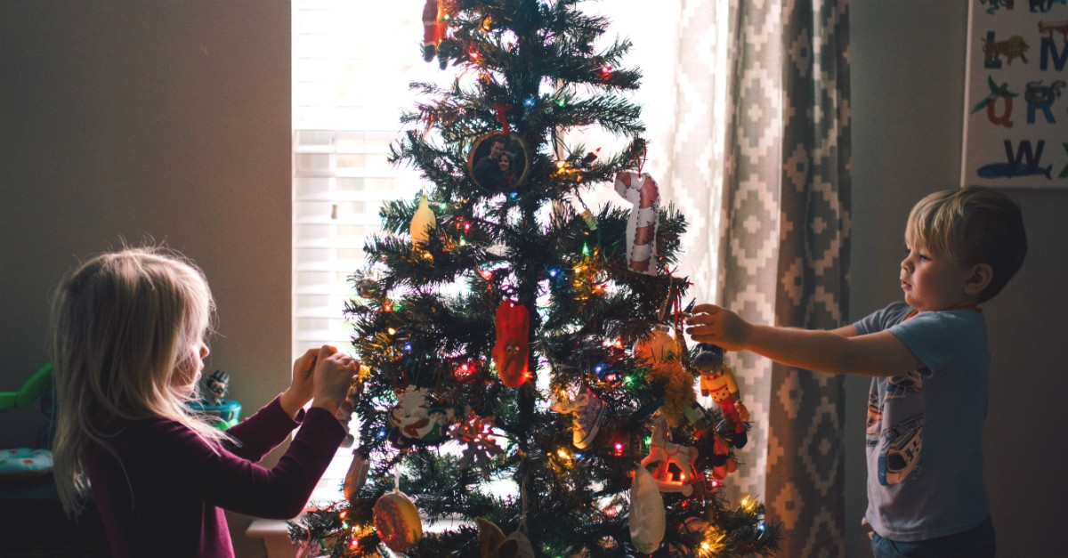 Young kids decorating a Christmas tree