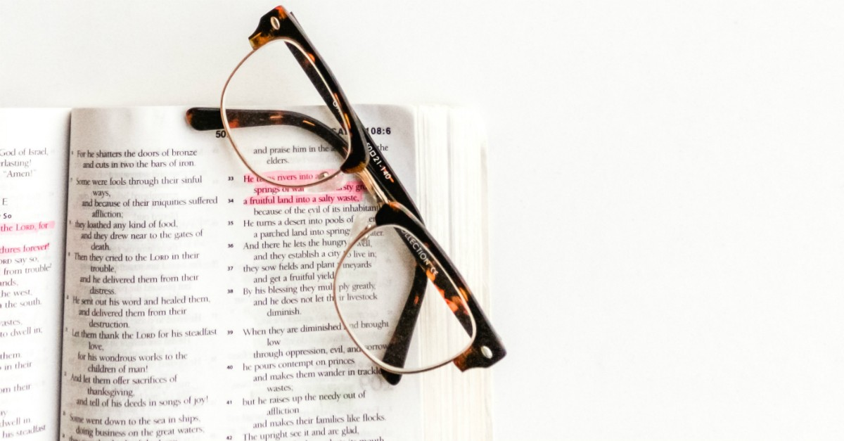 Pair of glasses over a Bible
