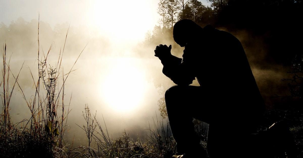 Man kneeling in the fog