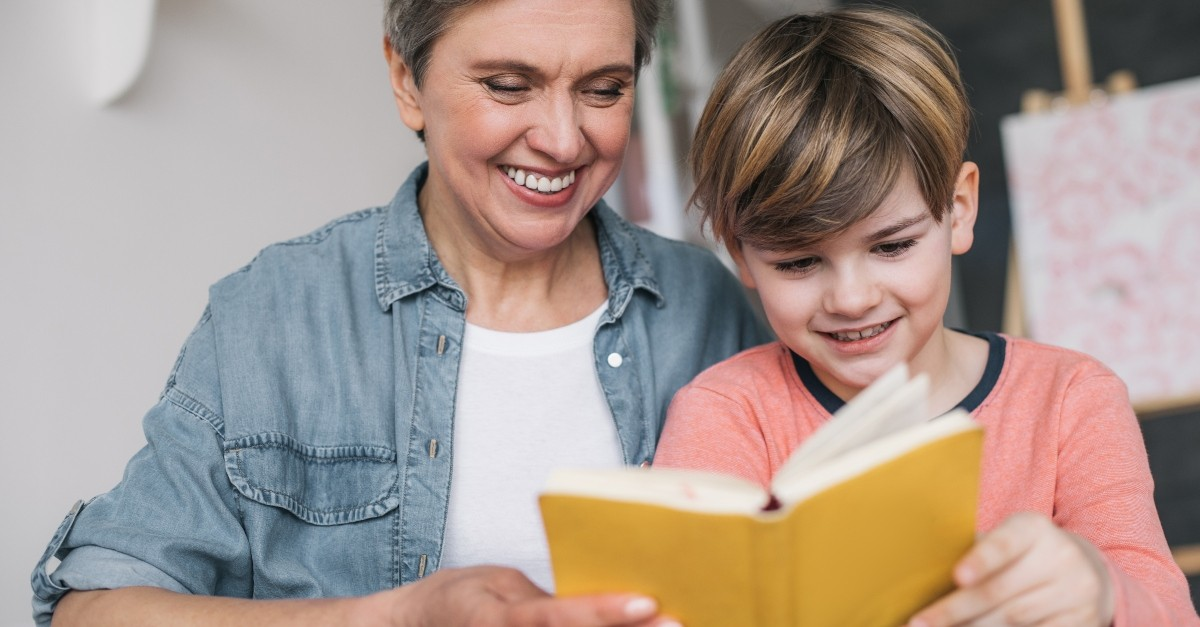 Grandmother and grandson reading a book together