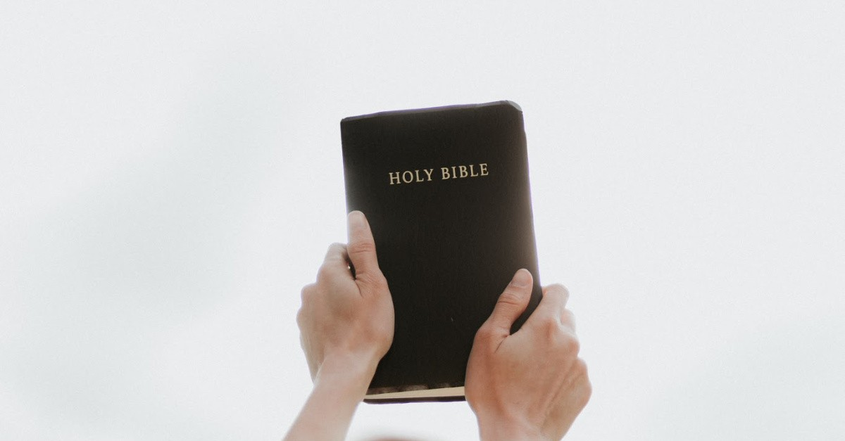 Person holding up a Bible