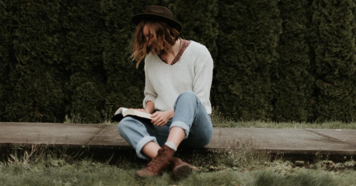 Woman reading a Bible outside