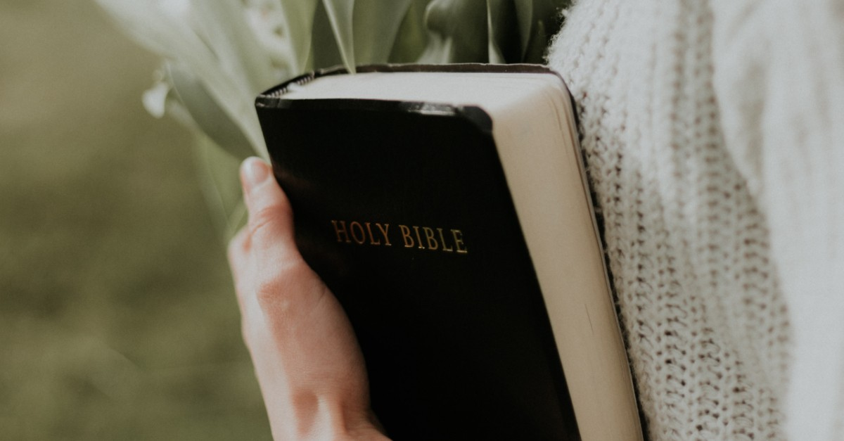 Close up of a woman holding a Bible