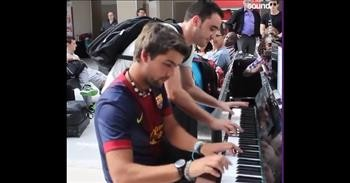 Complete Strangers Perform Impromptu Piano Duet At Train Station