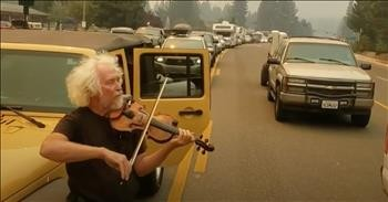 Man Plays Violin In The Middle Of Traffic As Resident Flee Wildfires