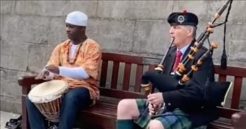 Street Performers Combine Scottish Bagpipes And African Drums