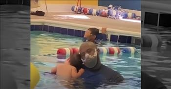 Baby And Swim Instructor Share Sweet Moment During Lesson