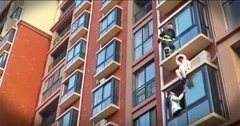 Firefighter Rescues Suicidal Woman From Side Of Building