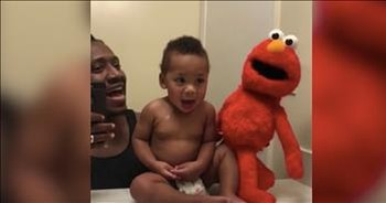 Dad Entertains Baby With Spot-On Elmo Impersonation