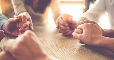 group holding hands praying, praying doesn't have to be hard