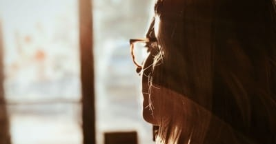 woman thinking, choose your God carefully