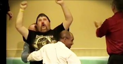 Excited Man Jumps Out Of Water After Baptism