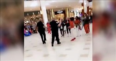 Police Officers Start To Break Up Christmas Flash Mob But Then Join In