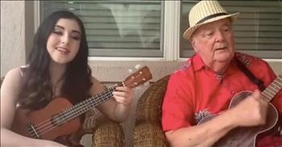 Grandfather And Granddaughter Sing Ukulele Duet Of 'That's Amore'