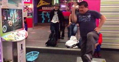 Older Man Steps Up To Dance Machine And Wows The Crowd With His Moves