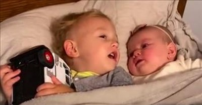 Sweet Toddler Soothes Crying Baby Sister