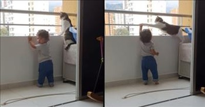 Protective Cat Keeps Watch Over Toddler Playing On Balcony