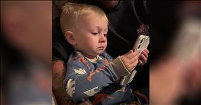 Toddler Tears Up Looking At Pictures Of His Parents