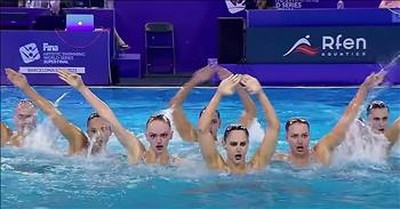 8 Synchronized Swimmers Step Up To The Side Of The Pool And Stun With Their 'Robot' Routine
