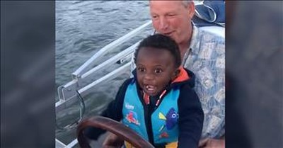 Toddler Has The Biggest Smile When Dad Lets Him Drive The Boat