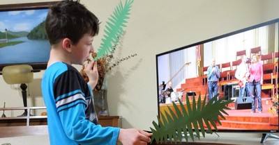 A kid watching virtual Sunday school, churches bring Sunday school home